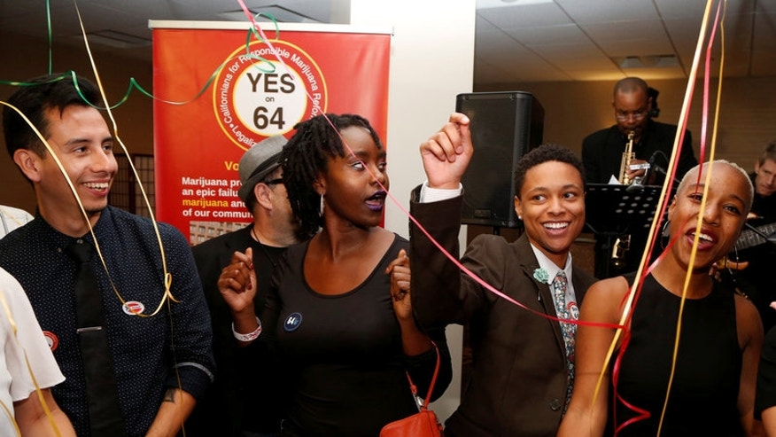 People celebrate after Californians voted to pass Prop 64, legalizing recreational use of marijuana in the state, in Los Angeles, California