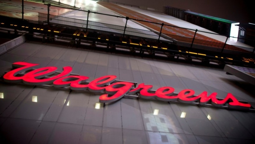 The logo of Walgreens is seen at their Times Square store in New York