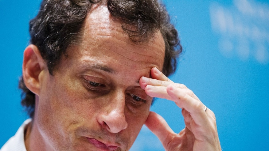 Anthony Weiner, a former U.S. congressman from New York and current democratic candidate for New York City Mayor, listens to fellow candidates speak at a debate held at the Museum of Tolerance in New York August 14, 2013.