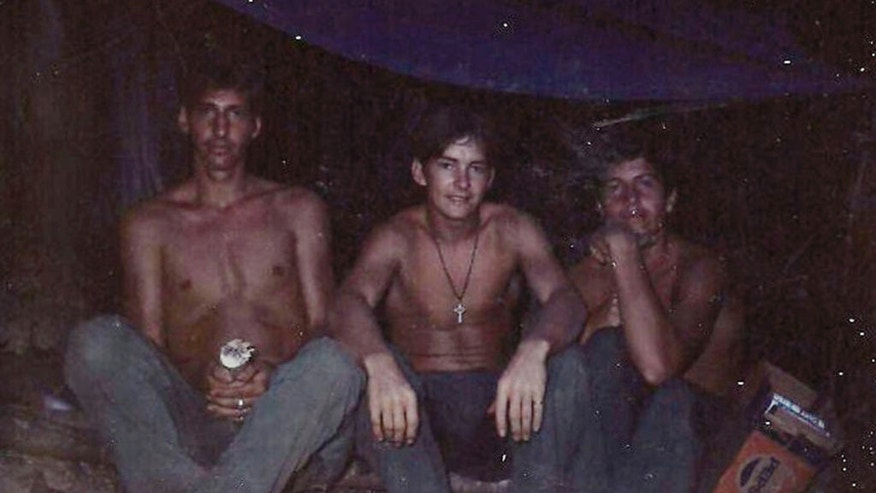 Mike Baughman, center, with fellow Army members during the Vietnam War. (Courtesy Mike Baughman via AP)