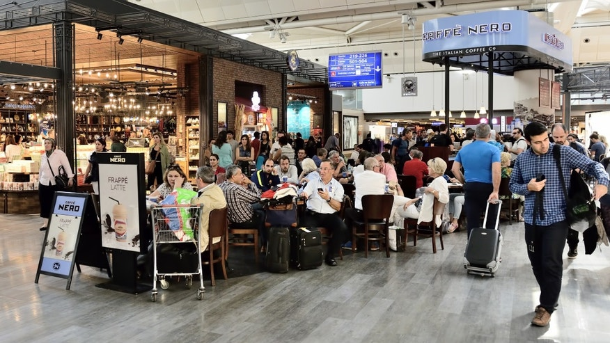 Travelers grab a bite to eat while waiting for a flight.