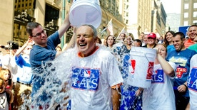 Major League Baseball Commissioner-elect Rob Manfred participates in the ALS Ice-Bucket Challenge outside the organization's headquarters in New York, Wednesday, Aug. 20, 2014. Manfred participated with more than 160 other MLB employees to raise more than $16,000 for the ALS Association. (AP Photo/Vanessa A. Alvarez)