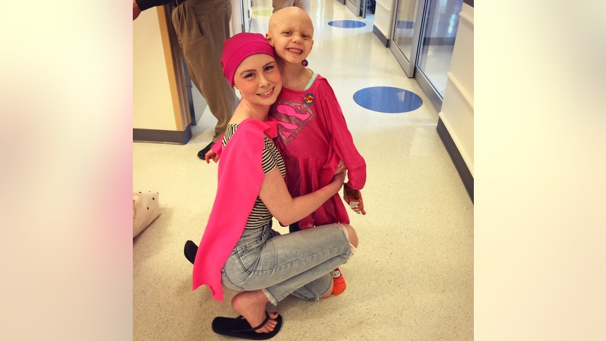 Kyla poses for a photo with her friend Kiley Sullivan, 7, in 2015.