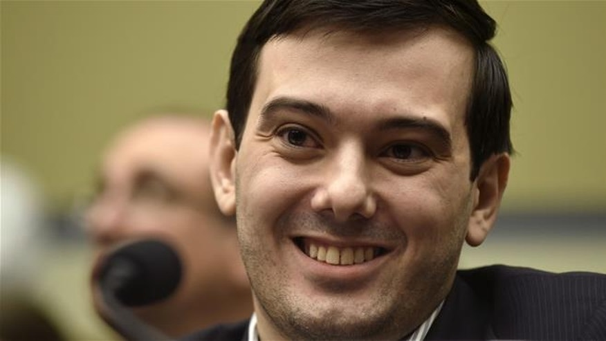 In this Feb. 4 file photo, Martin Shkreli smiles on Capitol Hill during a hearing on his former company's decision to raise the price of a lifesaving medicine.