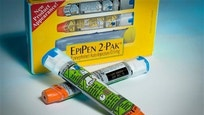 Examples of epinephrine pens that the Center for Disease Control and  Prevention guidelines recommend that schools stock to combat food allergies are photographed in Washington on Nov. 13, 2013.
