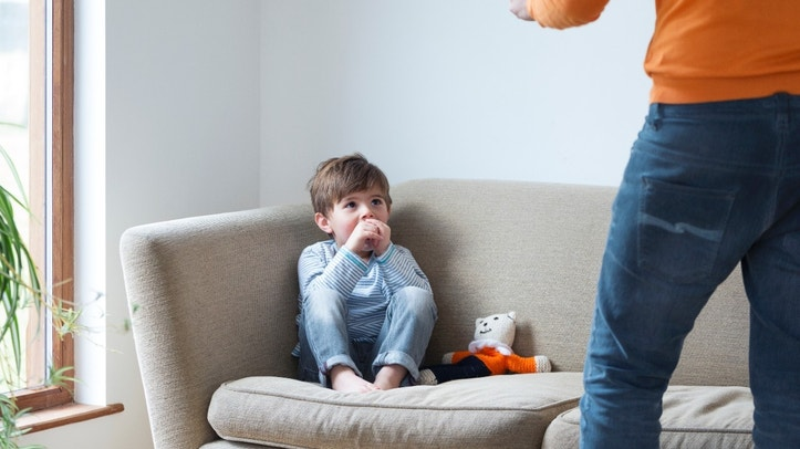 Little boy being shouted at by his dad.