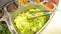 Pre-cut vegetables of self service salad bar are displayed for sale in shop in northern German town of Hamburg