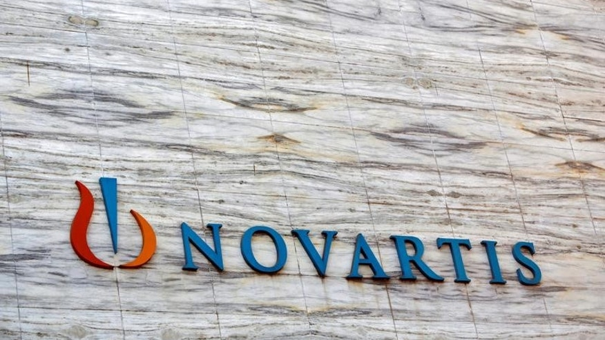 A Novartis logo is pictured on its headquarters building in Mumbai