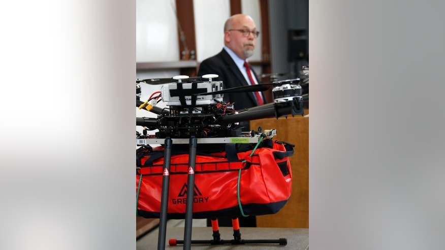 Richard W. Patrick, Senior Advisor for First Responder Policy with the U.S. Department of Homeland Security, looks at the drone equipped with a mass casualty medical kit, as he discusses the potential of life saving medical drones in the field, during a live telemedicine demonstration at John Bell Williams airport in Bolton, Miss., Tuesday, Dec. 6, 2016. (AP Photo/Rogelio V. Solis)