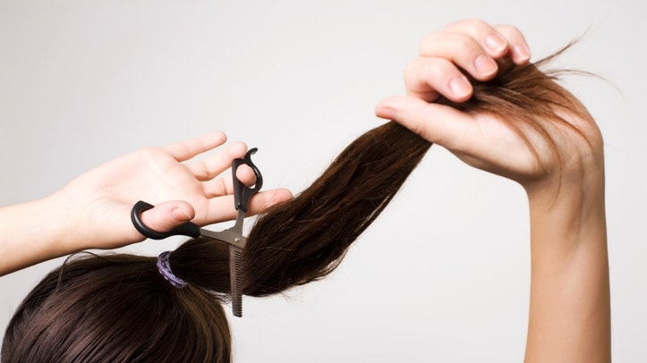 Woman cutting her ponytail - hair