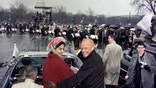 FILE - In this Feb. 26, 1962 file photo, Mercury astronaut John Glenn, and his wife, Annie, ride in the back of an open car with Vice-President Johnson during a parade in Glenn's honor in Washington. The Capitol is seen in the background. Glenn, the first American to orbit Earth who later spent 24 years representing Ohio in the Senate, died Thursday, Dec. 8, 2016, at the age of 95. (AP Photo/File)