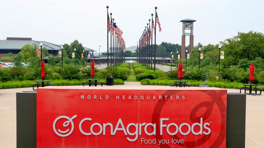 In this Tuesday, June 30, 2015, file photo, flags fly over ConAgra Foods world headquarters in Omaha, Neb.