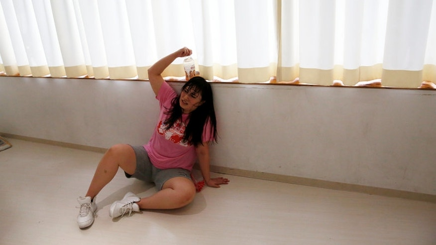Michiko Ohashi, a member of Pottya, takes a break while she practises her group's dance moves at a studio in Tokyo