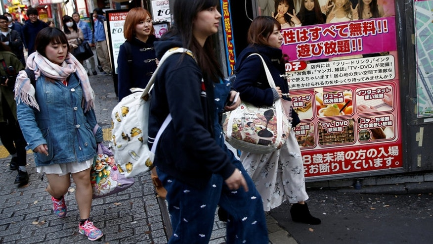 Members of Pottya make their way as they head to a restaurant for lunch after their dancing practice in Tokyo