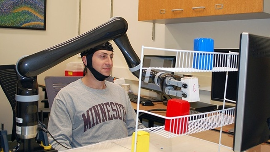 Research subjects at the University of Minnesota fitted with a specialized noninvasive brain cap were able to move the robotic arm just by imagining moving their own arms.