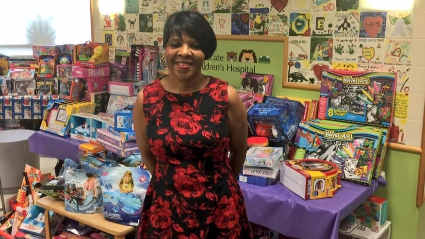 Jessie Tendayi, pictured here, has put aside a portion of her paycheck every year for the past seven holiday seasons to buy gifts for sick children at Advocate Children's Hospital in Oak Lawn, a suburb of Chicago. This year, she reportedly spent $5,000 on 1,000 toys.
