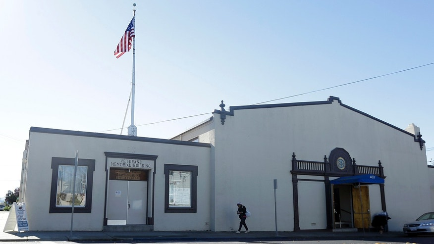 A woman walks in front of the American Legion Hall in Antioch, Calif. on Nov. 29, 2016.