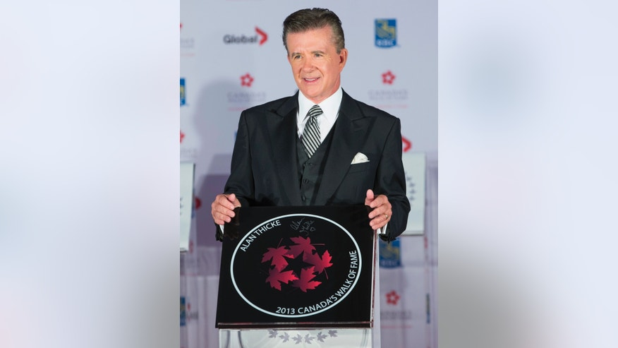 Actor Alan Thicke stands by his star during Canada's Walk of Fame induction ceremonies in Toronto, September 21, 2013.