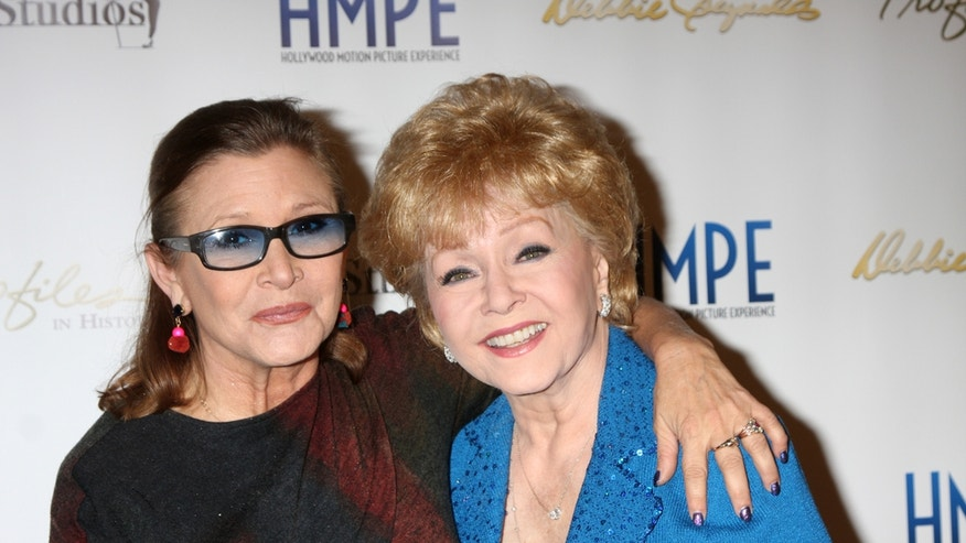 Debbie Reynolds (right) with her daughter, Carrie Fisher, in North Hollywood, California in 2014.
