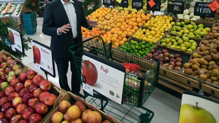 In this Tuesday, Dec. 6, 2016 photo, Brian Wansink, a food behavior scientist at Cornell University, speaks during an interview in the produce section at a supermarket in Ithaca, N.Y. In a study of 1,200 shoppers, every minute spent in the produce section meant $1.80 more in fruit and vegetable sales. (AP Photo/Mike Groll)