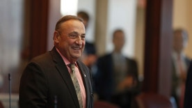 FILE- In this Dec. 19, 2016, file photo, Maine Republican Gov. Paul LePage arrives in the House Chamber at the State House in Augusta, Maine. LePage has gone three months without a press conference and has retreated to friendly talk-radio stations and conservative online outlets. (AP Photo/Robert F. Bukaty, File)