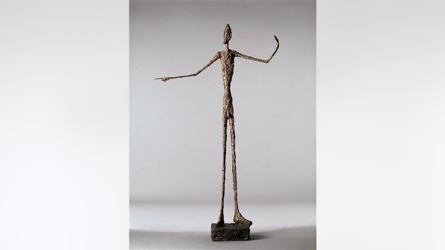 "A file photo of Alberto Giacometti's life-size ""Pointing Man."""