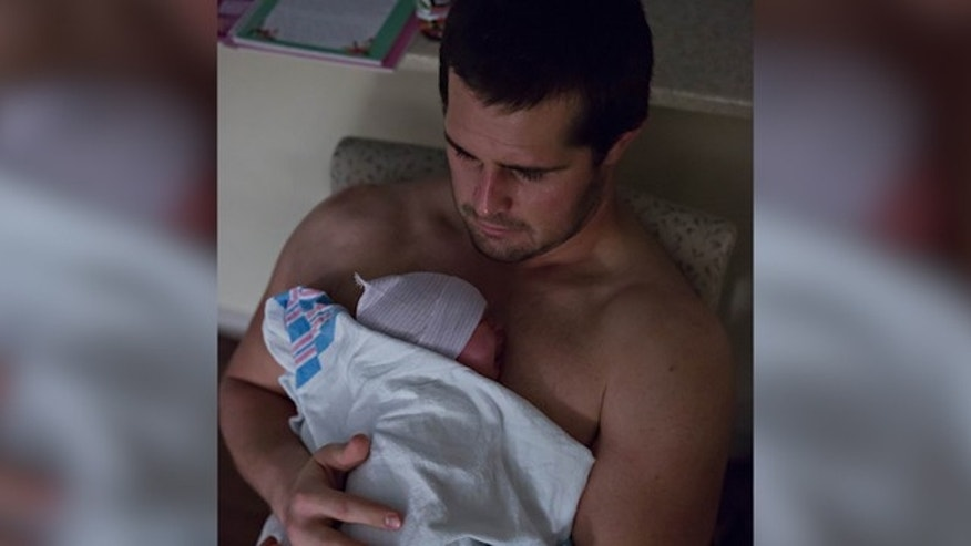 Andy Levitre with baby Lily (Fox 5 Atlanta)