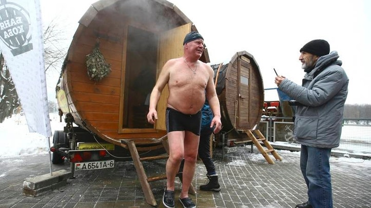 Man leaves sauna during Belarusian winter swimming championship in Minsk