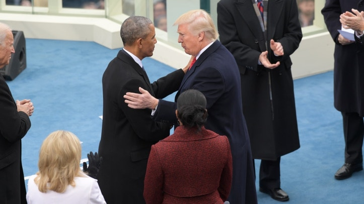 President-elect Donald Trump, left, shakes hands with President Barack Obama before the 58th Presidential Inauguration at the U.S. Capitol in Washington
