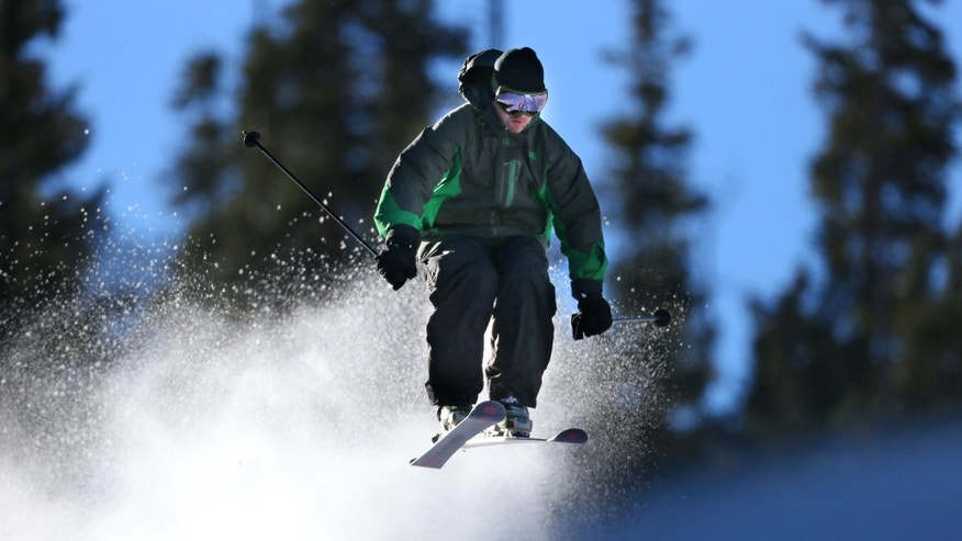 A skier enjoys opening day at Arapahoe Basin Ski Area in Colorado.