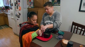 """This image released by Twin Cities PBS shows Daisy Duarte, right, caring for her mother Sonia, who was diagnosed with a genetic form of early-onset Alzheimer's, in a scene from the PBS documentary, """"Alzheimer's: Every Minute Counts.""""  It airs Wednesday at 10 p.m. EST. (Twin Cities PBS via AP)"""