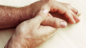 An elderly man has pain in fingers and hands
