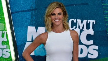 Show co-host Erin Andrews arrives at the 2015 CMT Awards in Nashville, Tennessee June 10, 2015. REUTERS/Eric Henderson - RTX1G07R
