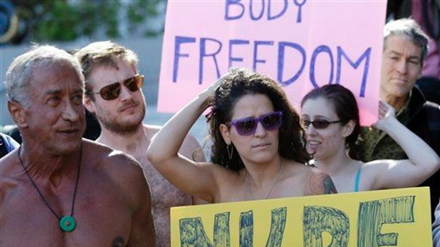 Demonstrators gather outside of City Hall in San Francisco for a protest against a proposed city-wide nudity ban, Wednesday,  Nov. 14, 2012.
