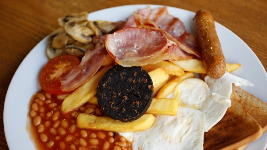 A traditional full English breakfast is pictured at 'Enough To Feed an Elephant' cafe in London