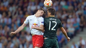 Salzburg's Marcel Sabitzer, left, and Celtic's Stefan Scepovic challenge for the ball during the Europa League group D soccer match between FC Salzburg and Celtic FC in the Arena in Salzburg, Austria, on Thursday, Sep. 18, 2014. (AP Photo/Kerstin Joensson)