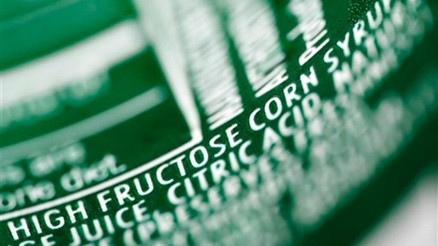 High fructose corn syrup is listed as an ingredient on a can of soda.