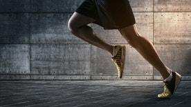 Close up of urban runner's legs run on the street with copy space