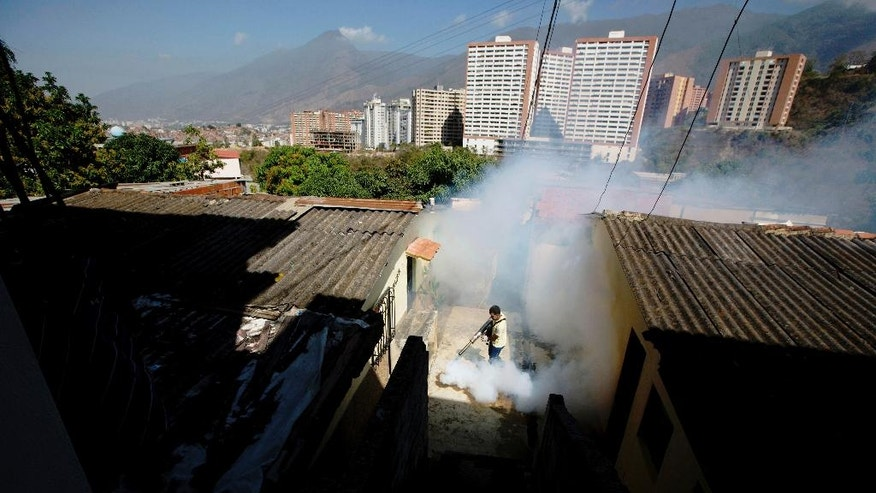 Feb. 1, 2016: In this file photo, a Sucre municipality worker fumigates for Aedes aegypti mosquitoes that transmit the Zika virus in the Petare neighborhood of Caracas, Venezuela.