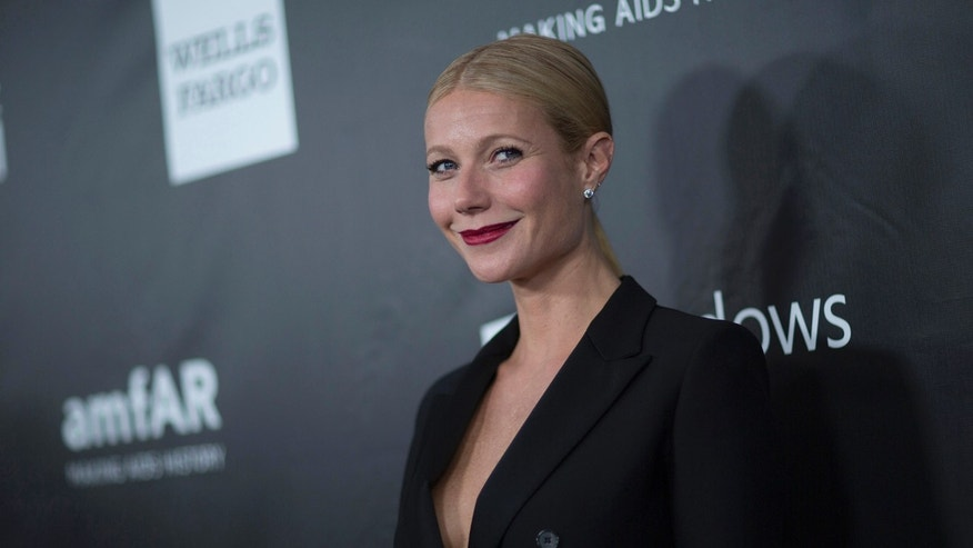 Actress Gwyneth Paltrow poses at the amfAR's fifth annual Inspiration Gala in Los Angeles, California October 29, 2014.