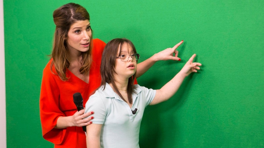March 15, 2017: Melanie Segard, right, is assisted by France 2 weather presenter Chloe Nabedian during an undated training at France Televisions headquarters in Paris, France.
