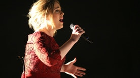 FILE - In this Feb. 15, 2016, file photo, Adele performs at the 58th annual Grammy Awards in Los Angeles. A video posted by a fan on Twitter May 29, 2016, shows the singer calling out a fan for filming her concert. (Photo by Matt Sayles/Invision/AP, File )