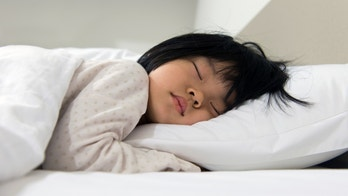 Portrait of Asian child sleeping on the bed