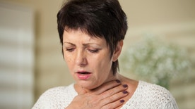 Mature woman with sore throat