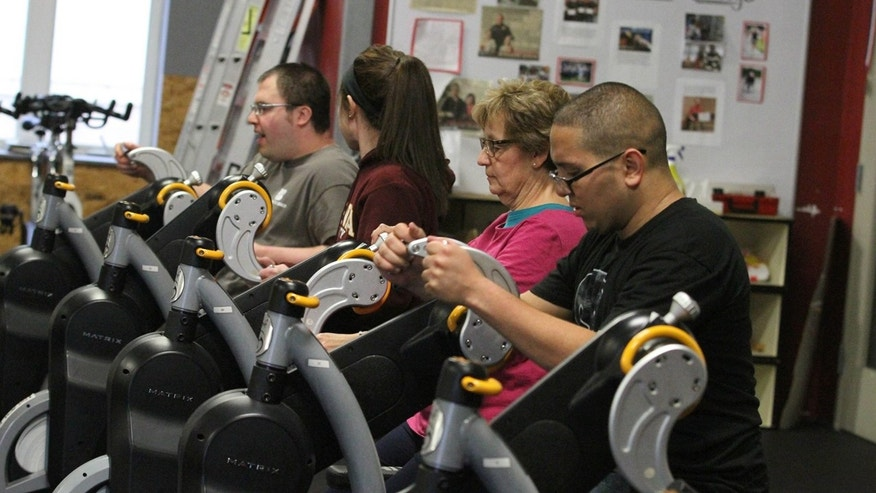 Participants work out on an adaptive machine during an ALL Abilities Fitness Class