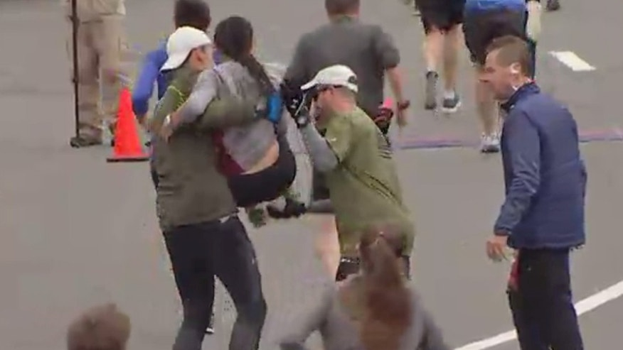 Runners help woman cross finish line at Philadelphia half-marathon