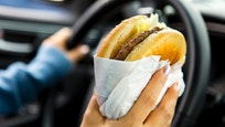 Eating Hamburger while driving