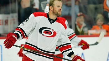 Carolina Hurricanes' Bryan Bickell skates during the warmups prior to the start of an NHL game against the Philadelphia Flyers, Sunday, April 9, 2017, in Philadelphia. This is the last game he will play in after announcing his retirement four games ago. (AP Photo/Tom Mihalek)