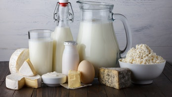 Dairy products on wooden table still life