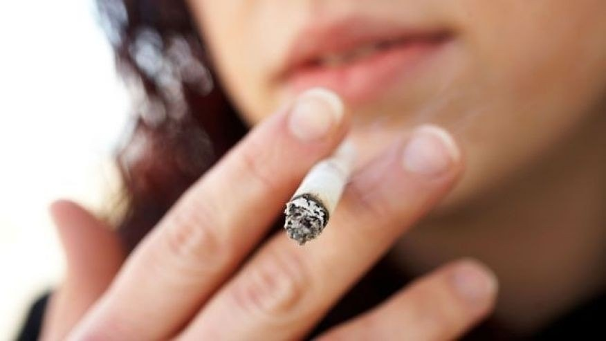 The thinking is that the smoking damages the eggs developing in a smoker's female fetus.